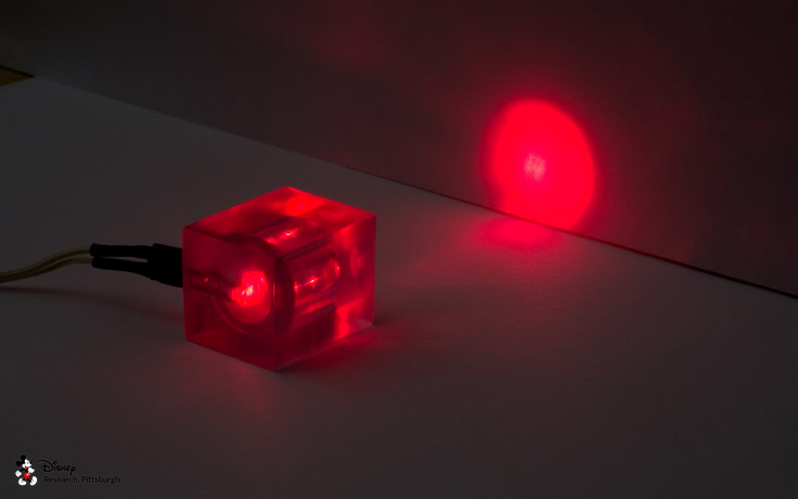 An LED embedded in a 3D printed lens to focus light.